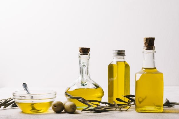 garrafas com azeite e copiadora